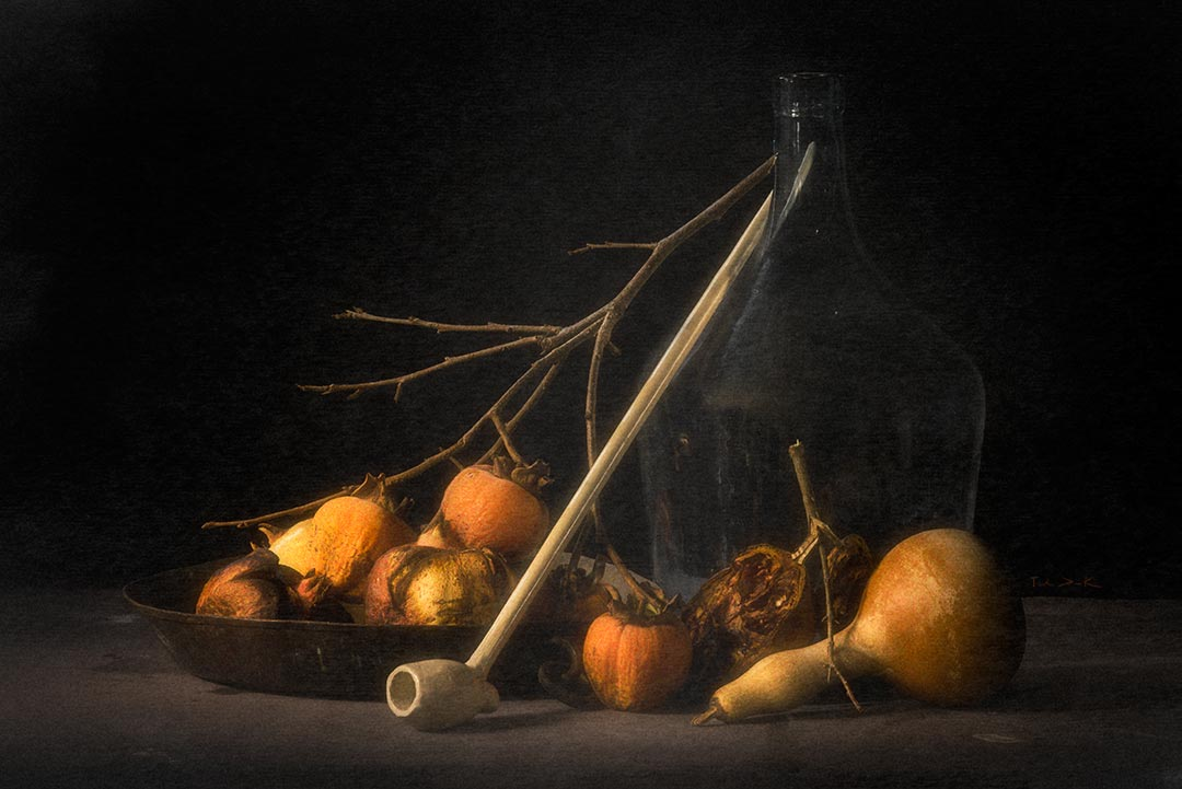 Still life with kakis, pomegranates, pumpkin, pipe and a glass vase