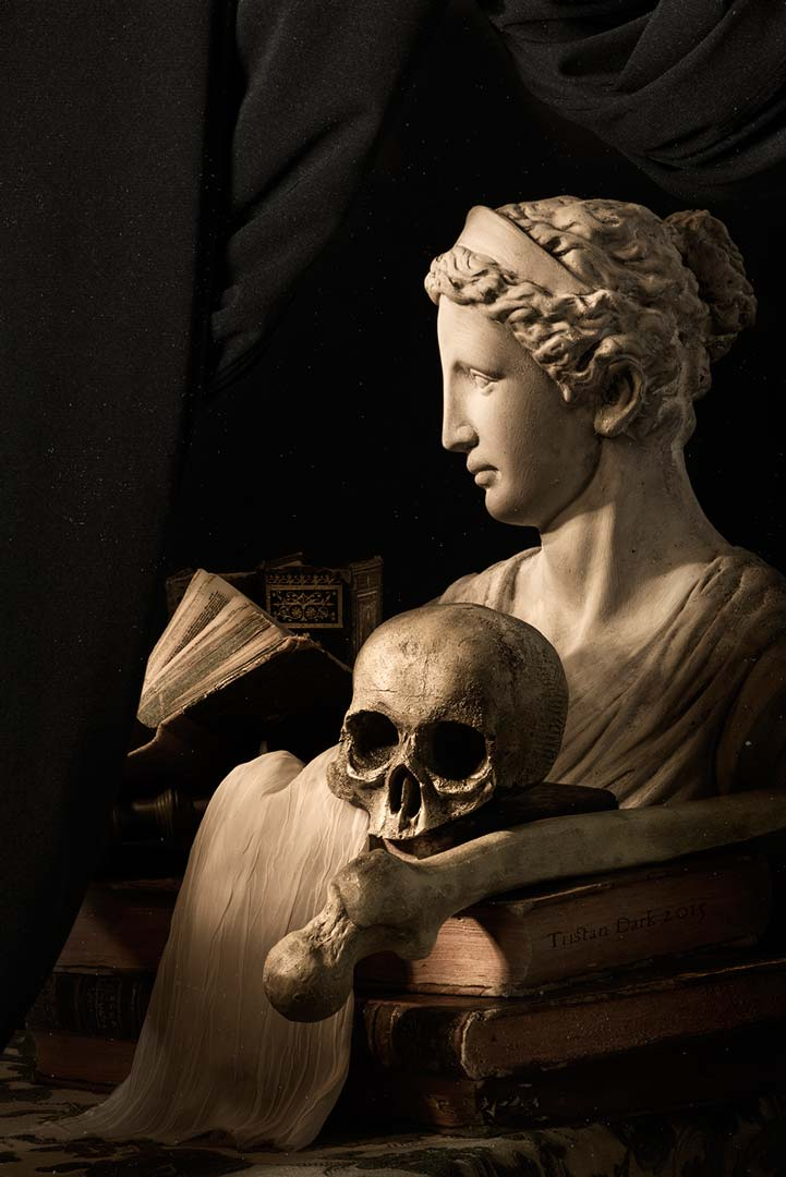 Skull with Greek statue, bones and books